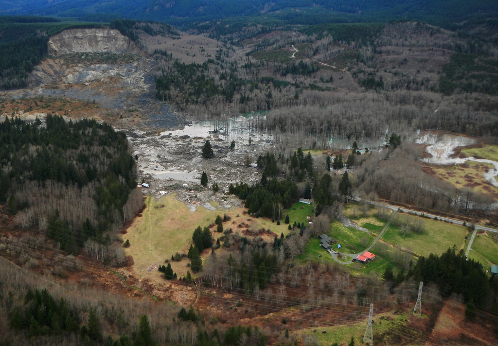 . This March 23, 2014 photo, made available by the Washington State Dept of Transportation shows a view of the damage from Saturday\'s mudslide near Oso, Wash.  (AP Photo/Washington State Dept of Transportation)
