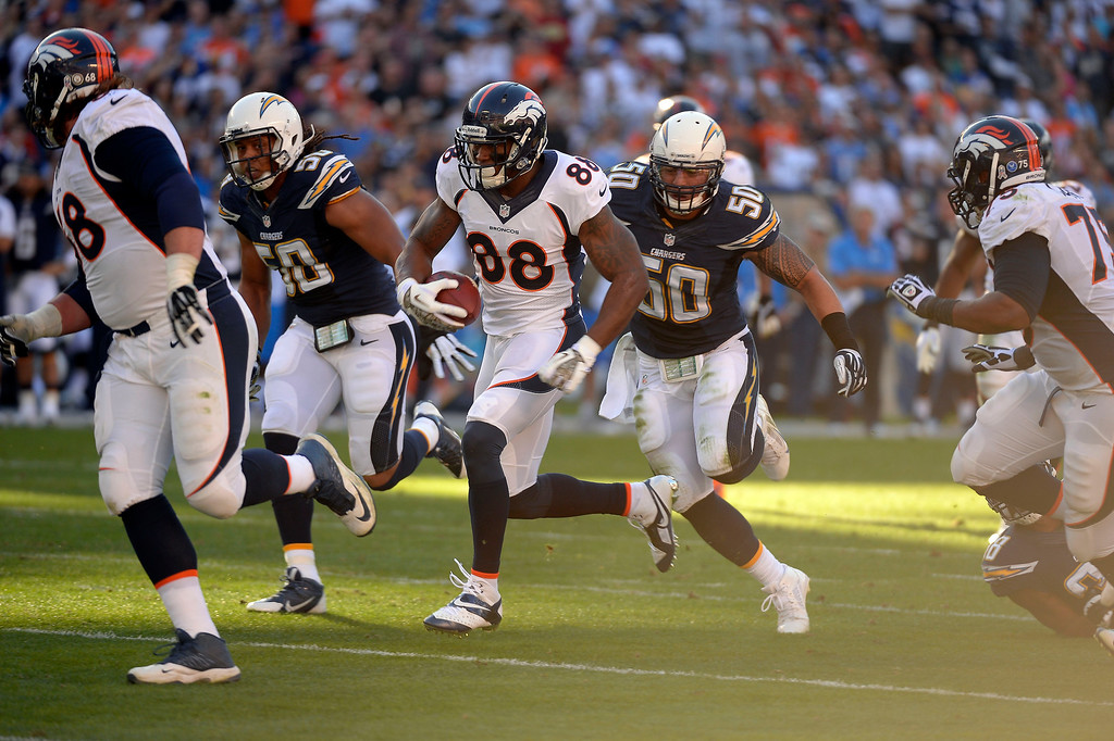 . Denver Broncos wide receiver Demaryius Thomas (88) splits the San Diego Chargers defense as he heads to the end zone for a touchdown in the third quarter at Qualcomm Stadium. (Photo by John Leyba/The Denver Post)