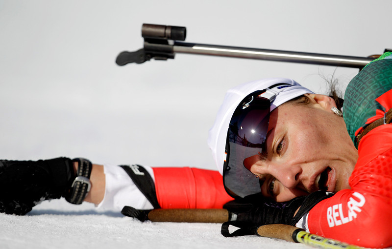 . Liudmila Kalinchik of  Belarus collapses on the finish line during the women\'s biathlon 15 km individual race at the Vancouver 2010 Olympics in Whistler, British Columbia, Thursday, Feb. 18, 2010. (AP Photo/Andrew Medichini)