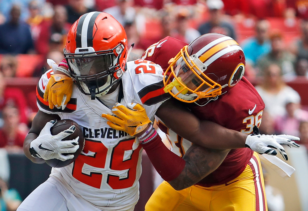 . Cleveland Browns running back Duke Johnson (29) is tackled by Washington Redskins defensive back Su\'a Cravens (36) during the first half of an NFL football game, Sunday, Oct. 2, 2016, in Landover, Md. (AP Photo/Carolyn Kaster)