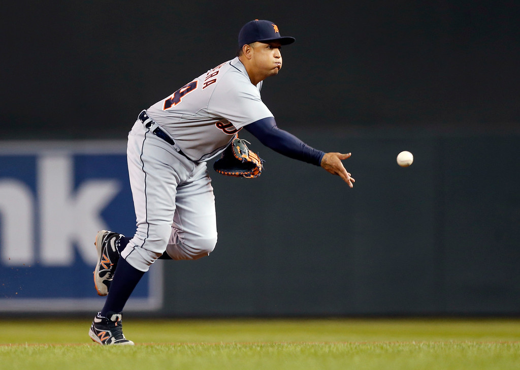 . Detroit Tigers first baseman Miguel Cabrera tosses the ball to pitcher David Price, who was covering first base, as he fields a grounder by Minnesota Twins\' Jordan Schafer in the fourth inning of a baseball game, Monday, April 27, 2015, in Minneapolis. (AP Photo/Jim Mone)