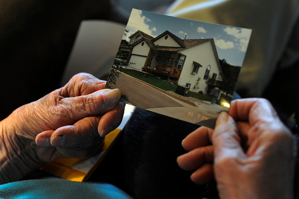 ". Lauretta Anzalone looks at pictures of her Mountain Shadows home that was destroyed in the Waldo Canyon fire in Colorado Springs, CO, Saturday, June 30, 2012. She is currently staying with her niece Jayne Lee, right, and her husband David, in Colorado Springs. Anzalone said, ""Things can be replaced, everyone is safe. It\'s out of our control so you gotta do what you gotta do.\"" Looking at the photographs she says, \""I think back on all the places I\'ve lived and I think this house was my favorite.\"" Craig F. Walker, The Denver Post"