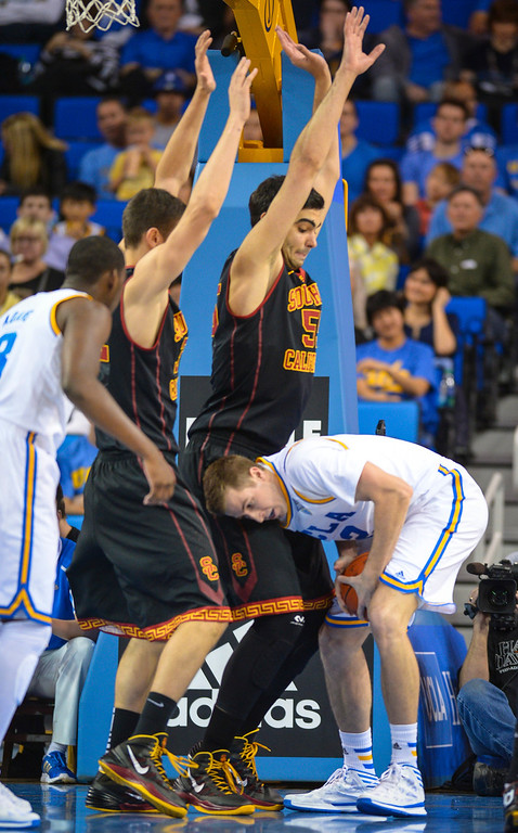 . UCLA�s David Wear comes up against USC�s Omar Oraby and Nikola Jovanovic during game action at Pauley Pavilion Sunday, December 5, 2014. UCLA  defeated USC 107-73.  Photo by David Crane/Los Angeles Daily News.