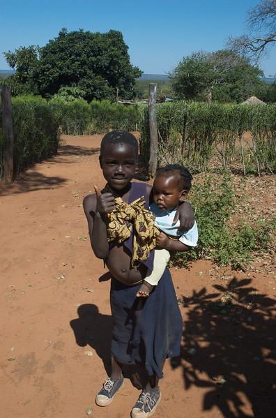 Eunis and little sister, Simonga Village, Zambia - Leslie Rowley