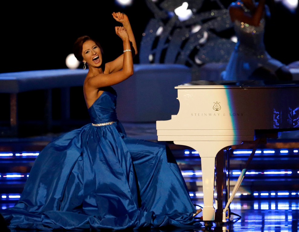 . Miss Massachusetts Lauren Kuhn plays the piano during the talent portion of the Miss America 2015 pageant, Sunday, Sept. 14, 2014, in Atlantic City, N.J. (AP Photo/Mel Evans)