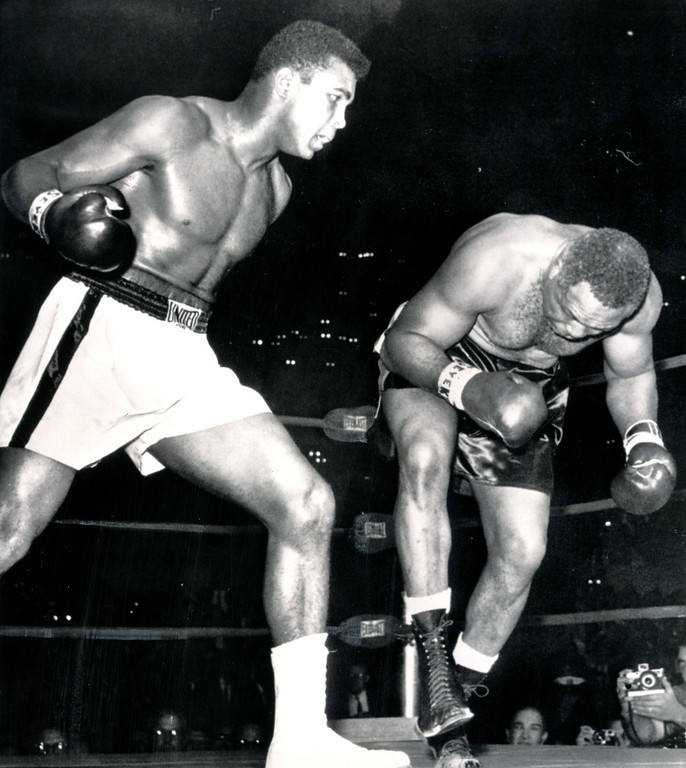 . LOS ANGELES, Nov.15, 1962--HEADED FOR THE CANVAS--Toppled by a barrage of lefts and rights, Archie Moore starts his second trip to the canvas in the fourth round of his scheduled 12-rounder against Cassius Clay in Los Angeles tonight.  When he went down for the third time referee Tommy Hart stopped the fight at one minute and 35 seconds. Credit: AP