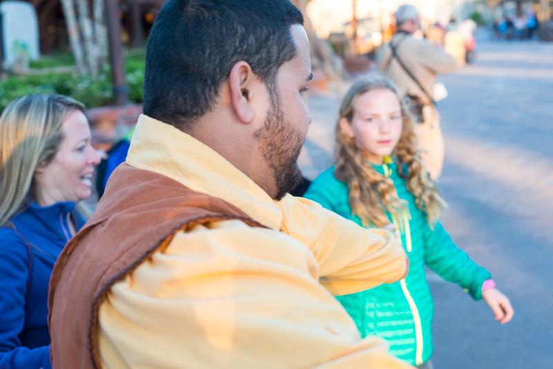 Cast Member Leads the Way to Mine Train - Magic Kingdom Walt Disney World