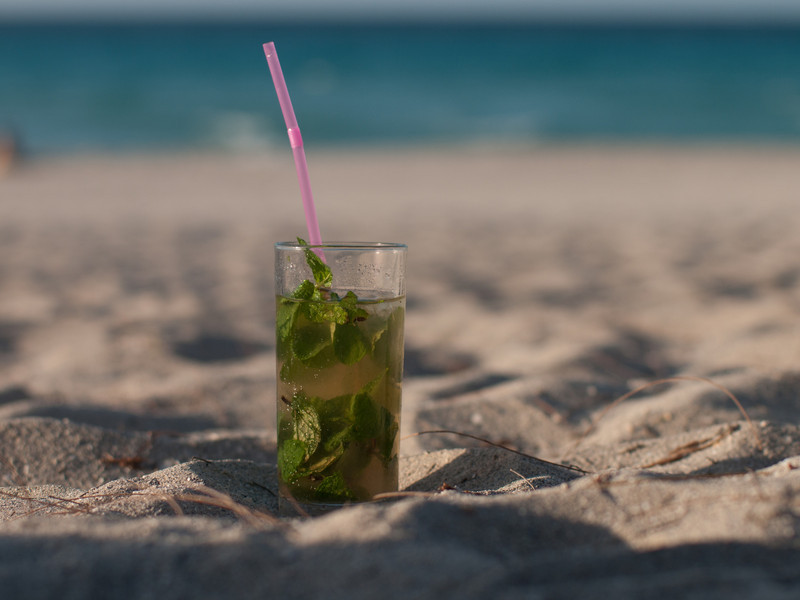 This mojito is brown due to the use of anejo rum instead of white. Was a good mohito, $2.