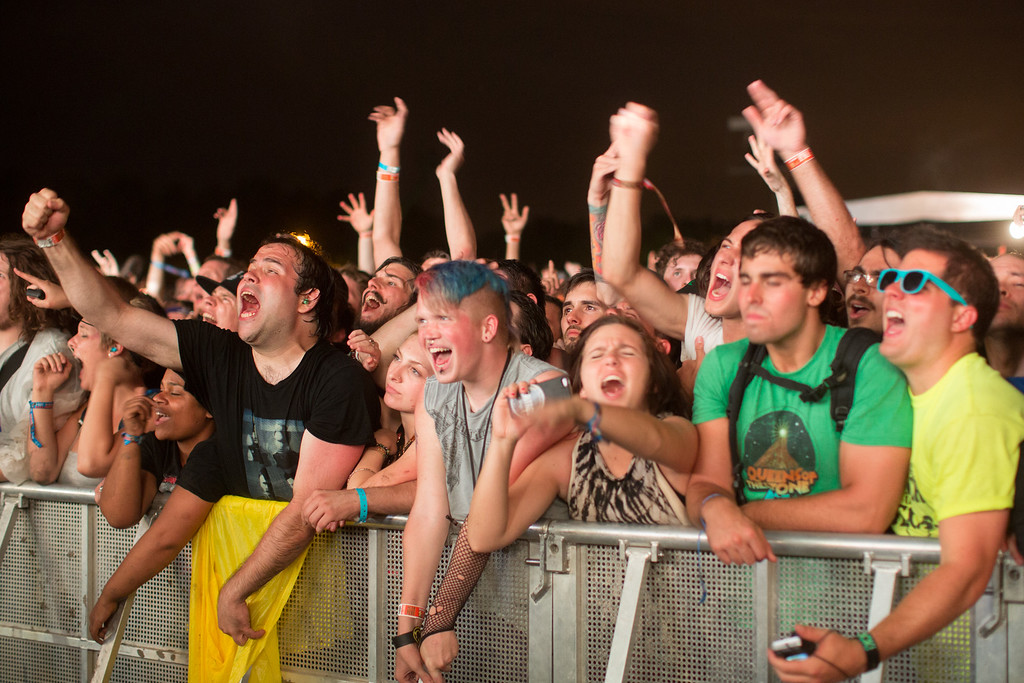 . Fans cheer while the band Nine Inch Nails performs at the Lollapalooza Festival in Chicago, Friday, Aug. 2, 2013. The more than two-decade-old festival opens Friday in Chicago\'s lakefront Grant Park. (AP Photo/Scott Eisen)