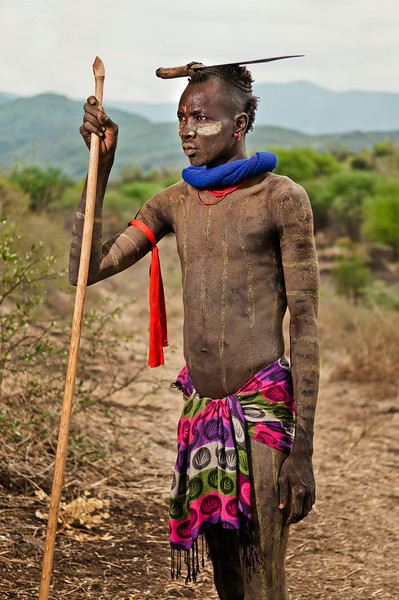 This is Lama Cawlo, a man from the Mursi tribe. The Mursi are the most populous tribe in Ethiopia's Omo Valley. They are well known for their unique lip plates. Mursi are a Nilotic pastoralist ethnic group that inhabit south-western Ethiopia. They principally reside in the Debub Omo Zone of the Southern Nations, Nationalities, and People's Region, close to the border with South Sudan. According to the 2007 national census, there are 7,500 Mursi.