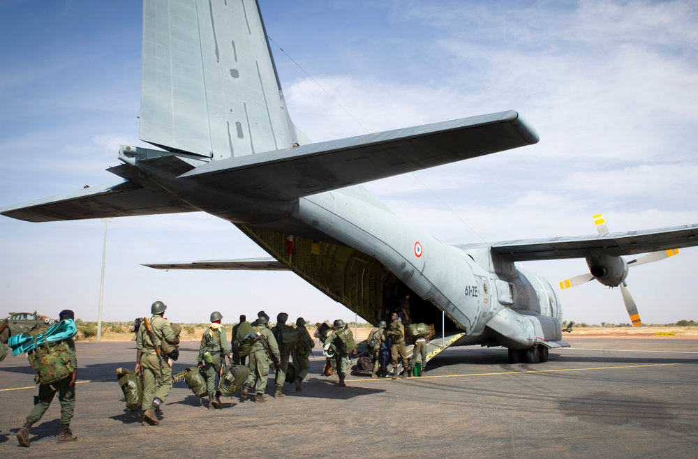 Description of . This picture provided by the French Army Communications Audiovisual office (ECPAD) and released Monday Jan. 28, 2013 shows Malian soldiers boarding a French Transall military plane in Bamako, Mali, Saturday Jan. 26, 2013. Malian forces were heading to Gao, north of Mali. French and Malian forces pushed toward the fabled desert town of Timbuktu on Sunday, as the two-week-long French mission gathered momentum against the Islamist extremists who have ruled the north for more than nine months. (AP Photo/Ghislain Mariette, EMA-ECPAD)