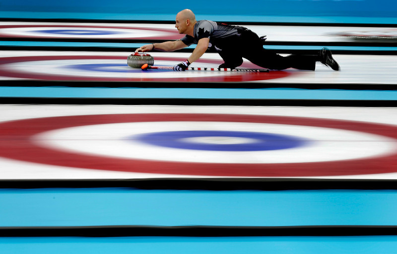 . Canada\'s Ryan Fry delivers the rock during the men\'s curling gold medal game against Britain at the 2014 Winter Olympics Friday, Feb. 21, 2014, in Sochi, Russia. (AP Photo/Wong Maye-E)