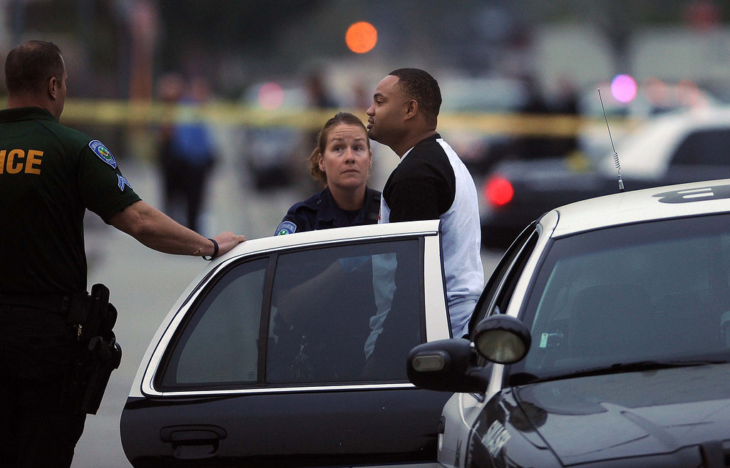 . San Bernardino Police officers investigate a fatal shooting after one person was shot and killed Monday March 18, 2013 in the 2900  block of Loma Avenue in San Bernardino.LaFonzo Carter/ Staff Photographer