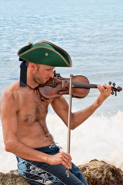 On Maho Beach, a violin playing pirate was the subject of a video that was being recorded.