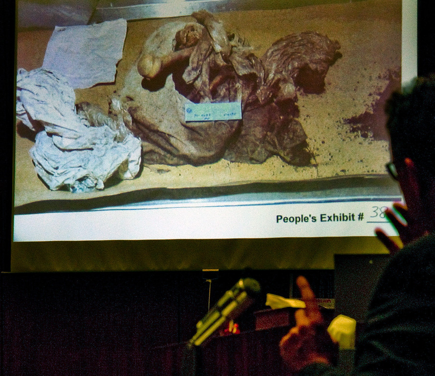 . Manuel Munoz who worked at a coroner looking at projected photo taken of himself  when he was a coroner examining the body of John Sohus  and examined the evidence.(SGVN/Photo by Walt Mancini/LANG)