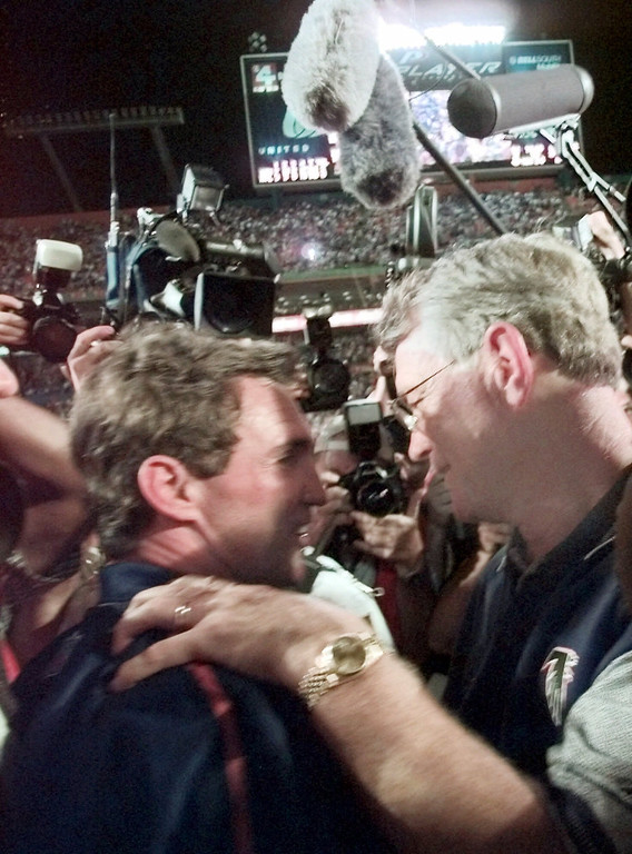 . Atlanta Falcons head coach Dan Reeves, right, and Denver Broncos head coach Mike Shanahan greet each other after the Broncos defeated the Falcons 34-19 at Super Bowl XXXIII in Miami, Sunday, Jan. 31, 1999.  (AP Photo/John Bazemore)