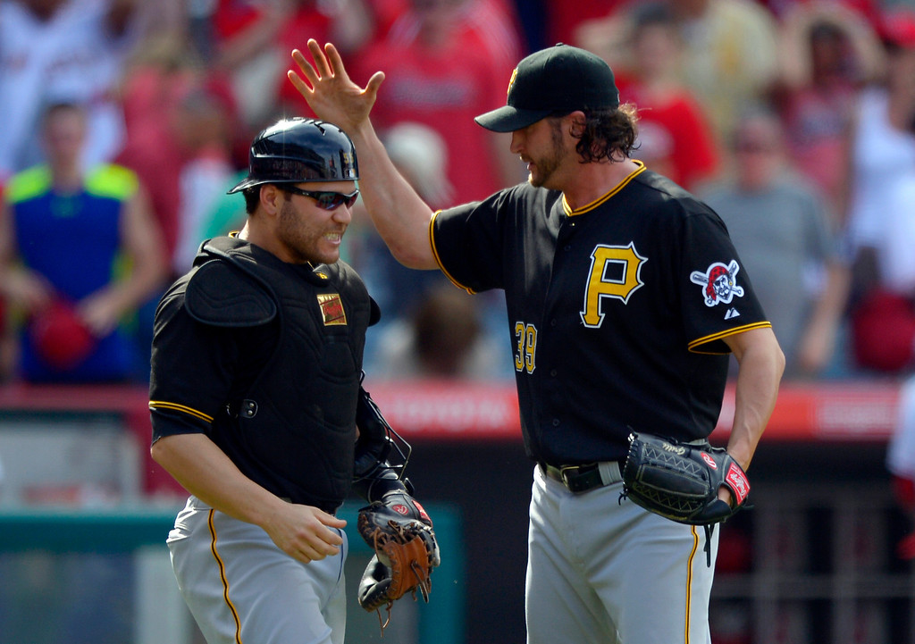 . Pittsburgh Pirates catcher Russell Martin, left, and relief pitcher Jason Grilli celebrate after they defeated the Los Angeles Angels 10-9 in their baseball game, Sunday, June 23, 2013, in Anaheim, Calif.  (AP Photo/Mark J. Terrill)
