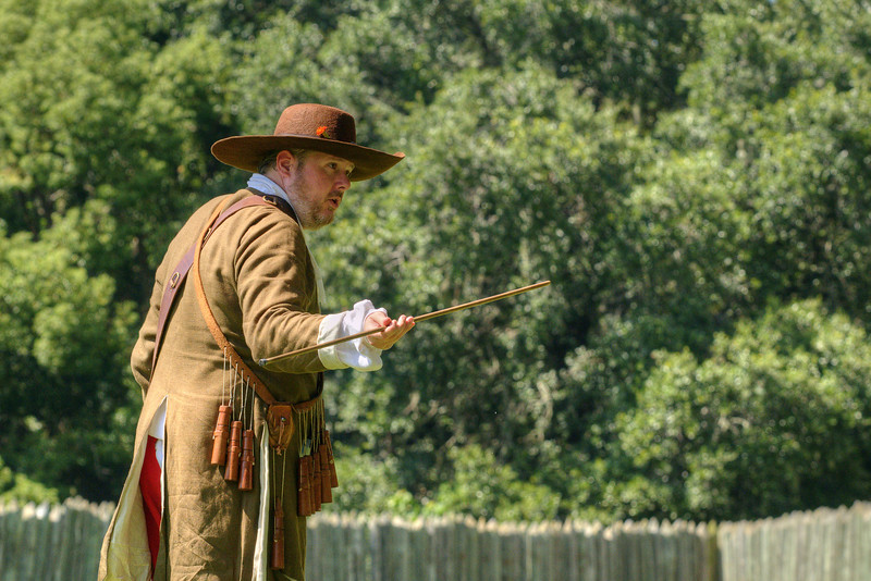 A reenactor demonstrates a matchlock musket at Charles Towne Landing State Historic Park in Charleston, SC on Saturday, September 7, 2013. Copyright 2013 Jason Barnette