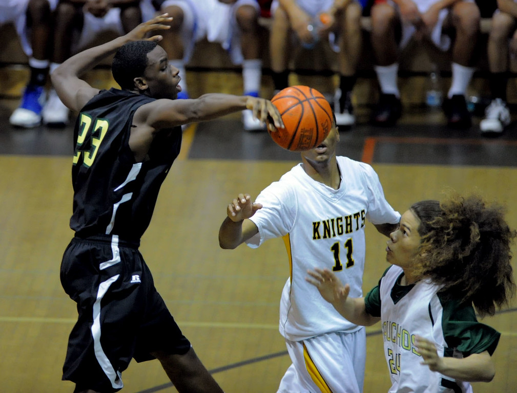 . 03-31-2010--(Staff Photo by Sean Hiller)-- The South Bay Athletic Club Senior All-Star boys basketball game Thursday at West Torrance High School. Blue Team\'s Austin  Sanford(23) of Narrbonne battles Red Team\'s Shailo Leafa(24) of Narbonne. Kyle Reid(11) of Bishop Montgomery is on guard for the Red.