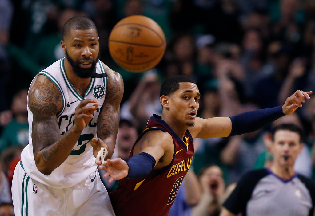 . Boston Celtics forward Marcus Morris (13) and Cleveland Cavaliers guard Jordan Clarkson (8) compete for a loose ball during the second half of Game 1 of the NBA basketball Eastern Conference Finals, Sunday, May 13, 2018, in Boston. (AP Photo/Michael Dwyer)