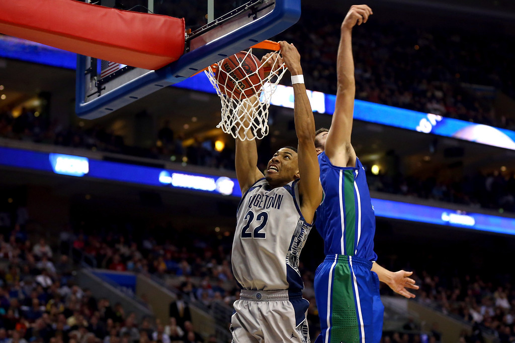 . PHILADELPHIA, PA - MARCH 22:  Otto Porter Jr. #22 of the Georgetown Hoyas dunks in the second hal fagainst Chase Fieler #20 of the Florida Gulf Coast Eagles during the second round of the 2013 NCAA Men\'s Basketball Tournament at Wells Fargo Center on March 22, 2013 in Philadelphia, Pennsylvania.  (Photo by Elsa/Getty Images)
