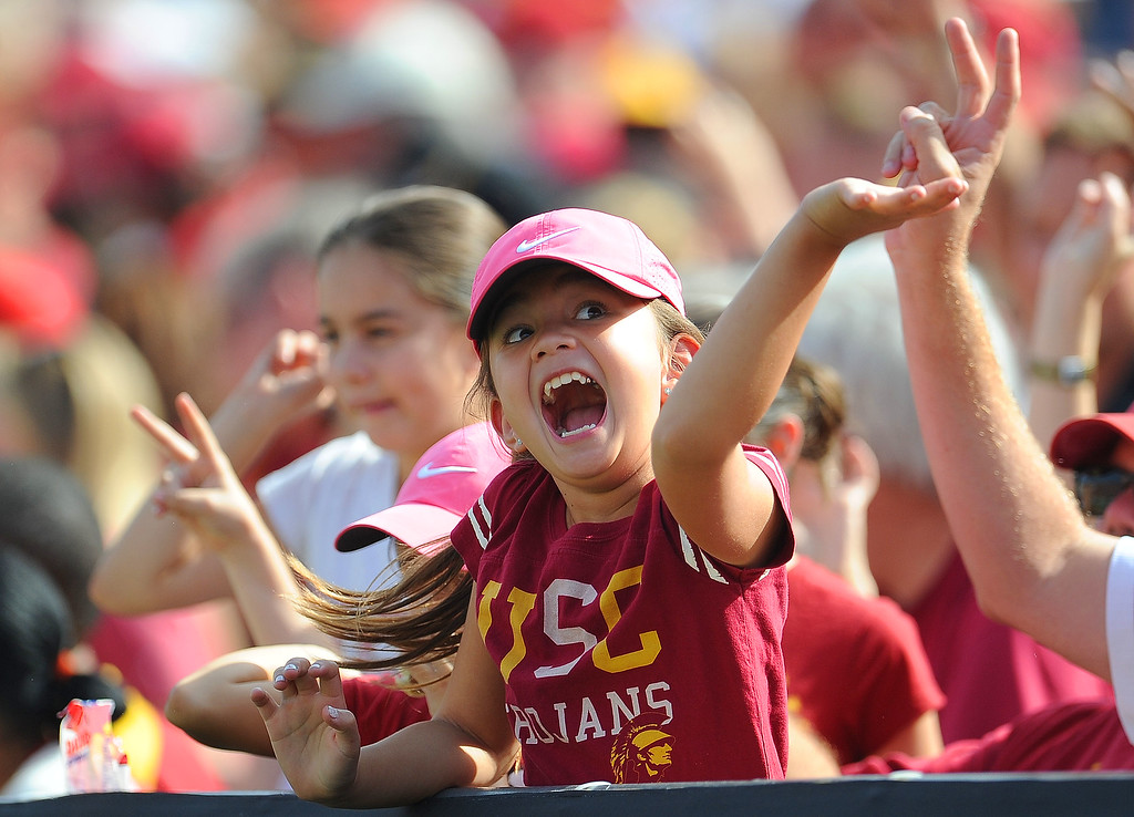 . Southern California fans react after a touchdown against Utah during the first half of an NCAA college football game in the Los Angeles Memorial Coliseum in Los Angeles, on Saturday, Oct. 26, 2013.  (Photo by Keith Birmingham/Pasadena Star-News)