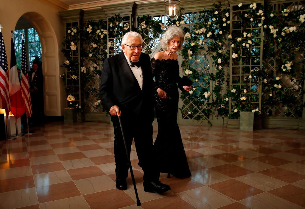 . Former U.S. Secretary of State Henry Kissinger and his wife, Nancy Kissinger, arrive for a State Dinner with French President Emmanuel Macron and President Donald Trump at the White House, Tuesday, April 24, 2018, in Washington. (AP Photo/Alex Brandon)