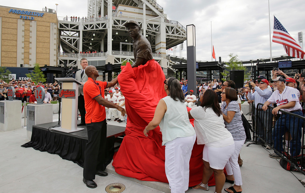 . Larry Doby Jr, left, along with other members of his family unveil a statue of Hall of Fame Larry Doby at Progressive Field Saturday, July 25, 2015, in Cleveland. Doby broke the color barrier in the AL on July 5, 1947, just months after Jackie Robinson played for the Brooklyn Dodgers. Doby spent nine seasons with Cleveland and helped lead the Indians to a World Series title in 1948. He had a career .283 average with 253 homers. He led the league with 32 homers and 126 RBIs in 1954, when the Indians won 111 games. Before joining the Indians, Doby starred for Newark in the Negro League. He retired following the 1959 season. Doby\'s No. 14 was retired in 1994, 47 years after he was signed by Indians owner Bill Veeck. A seven-time All-Star, Doby died in 2003 at the age of 79. (AP Photo/Tony Dejak)