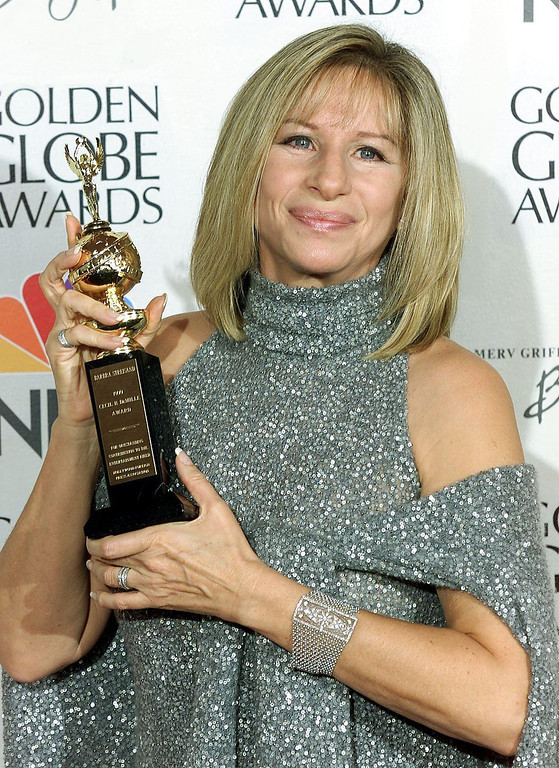 . Entertainer Barbra Streisand holds the Cecil B. DeMille Award at the 57th Golden Globe Awards in Beverly Hills, CA, 23 January 2000.  (Vince Bucci/AFP/Getty Images)