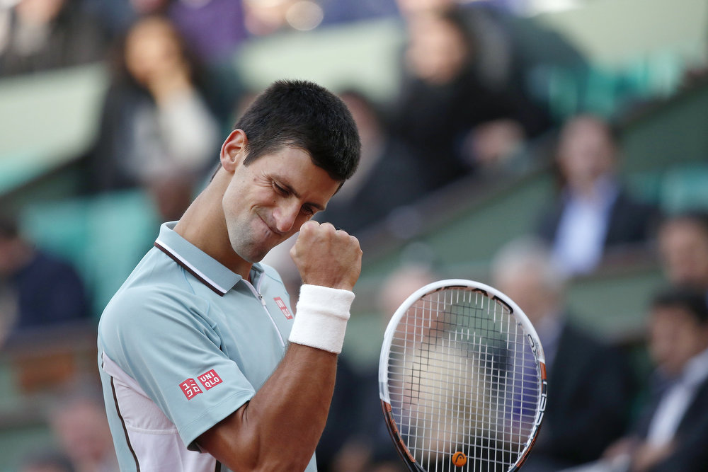. Serbia\'s Novak Djokovic reacts after a point against Belgium\'s David Goffin during a French tennis Open first round match at the Roland Garros stadium in Paris on May 28, 2013. THOMAS COEX/AFP/Getty Images