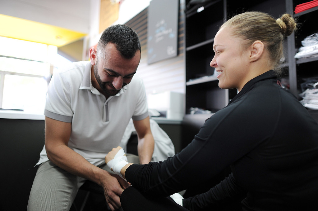 . Coach Edmond Tarverdyan works with UFC women\'s bantamweight champion Ronda Rousey at Glendale Fighting Club in Glendale Friday, January 31, 2014. (Photo by Hans Gutknecht/Los Angeles Daily News)