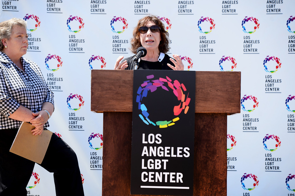 . Comedian Lily Tomlin speaks to the press after Lorri Jean, left, CEO of the Los Angeles LGBT Center,  announced a $25 million campaign to develop an affordable housing campus for LGBT youth and seniors Tuesday, May 27, 2014 on Santa Monica Boulevard in Hollywood and adjacent to their cultural center. Around 40 percent of the more than 6,000 homeless youth in Los Angeles identify as lesbian, gay, bisexual or transgender and the city has 65,000 LGBT seniors according to the L.A. Gay & Lesbian Center. The center has raised $19 million. (Photo by Sarah Reingewirtz/Pasadena Star-News)