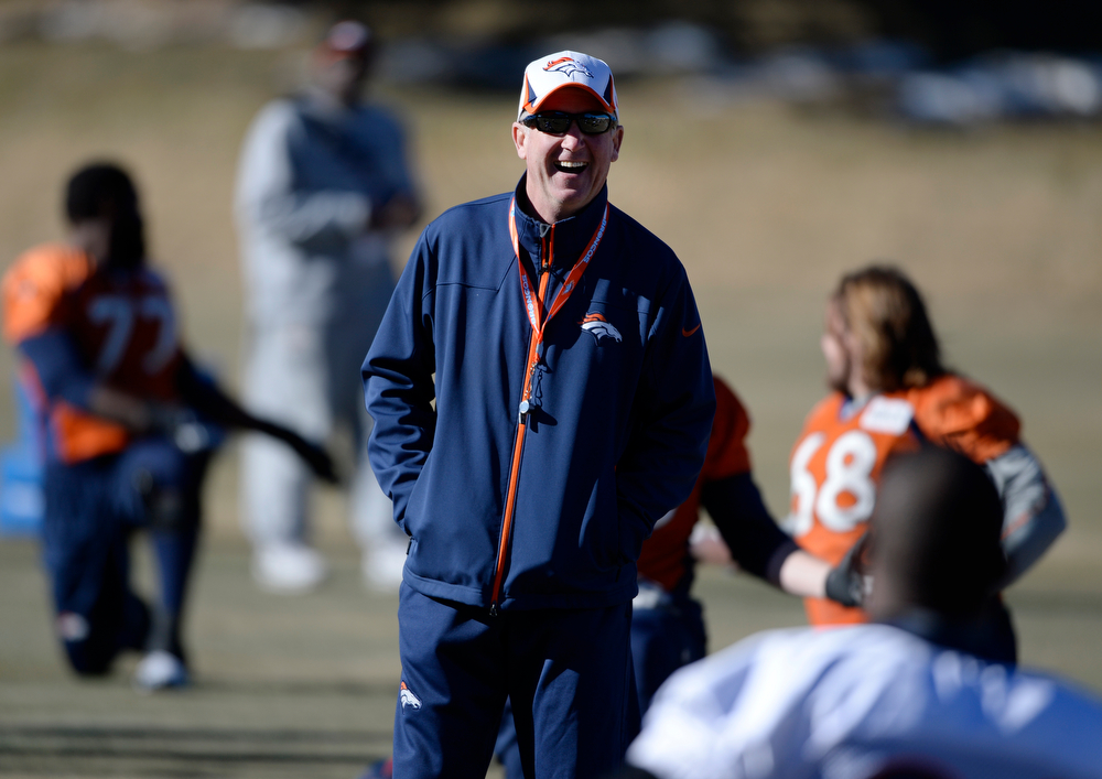 . Denver Broncos head coach, John Fox, has a laugh with players during practice at Dove Valley Saturday morning, January 25, 2014. (Photo By Andy Cross / The Denver Post)