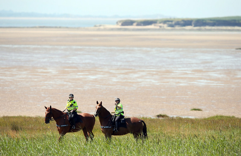 . Mounted police are seen outside the course on the opening day of the 2014 British Open Golf Championship at Royal Liverpool Golf Course in Hoylake, north west England on July 17, 2014. (ANDREW YATES/AFP/Getty Images)