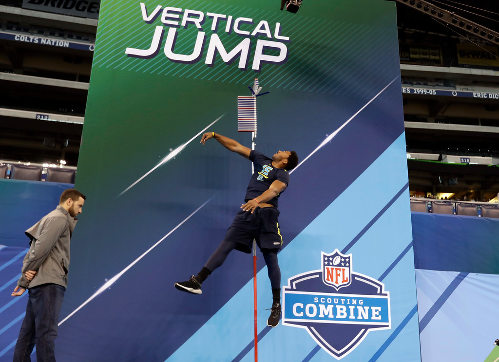 . Texas A&M defensive end Myles Garrett is tested in the vertical jump at the NFL football scouting combine Sunday, March 5, 2017, in Indianapolis. (AP Photo/David J. Phillip)