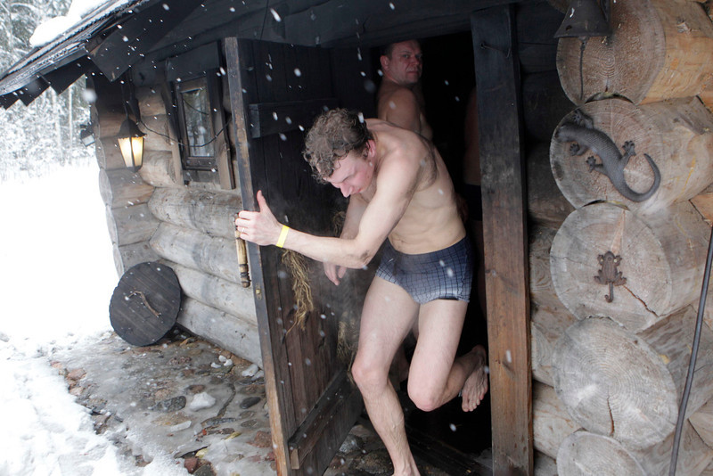 . REFILE - CORRECTING COUNTRY IN BYLINE   A man leaves a sauna during the European Sauna Marathon in Otepaa February 10, 2013. More than 600 participants took part in the event by visiting 20 saunas with a total distance of over 100 km (62 miles). Picture taken February 10, 2013.  REUTERS/Ints Kalnins (ESTONIA - Tags: SOCIETY)