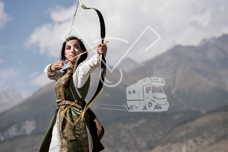 Hungarian archer aiming with her bow and wearing traditional clothes at the World Nomad Games 2018