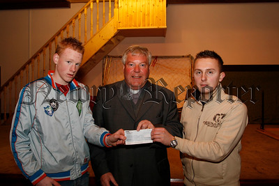 Proceeds from a fancy dress dance organised by the South-Down Defenders raised £533.00 for the Southern Area Hospice , Presenting the Cheque to Rev Norman Hutton are Gavin Martin & David Taylor, 07W7N66