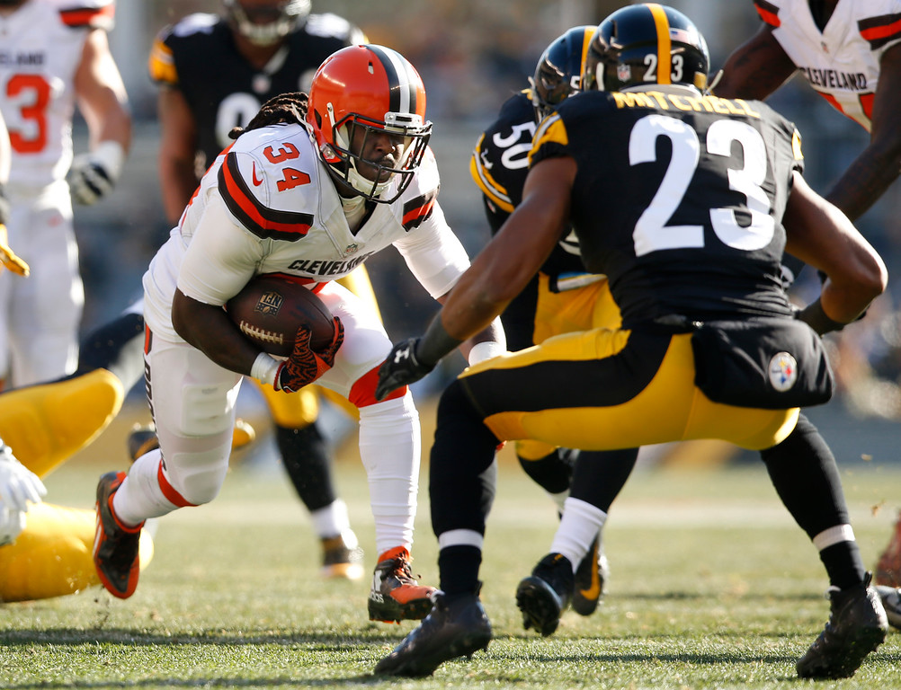 . Cleveland Browns running back Isaiah Crowell (34) carries the ball with Pittsburgh Steelers free safety Mike Mitchell (23) defending during the first half of an NFL football game in Pittsburgh, Sunday, Jan. 1, 2017. (AP Photo/Jared Wickerham)