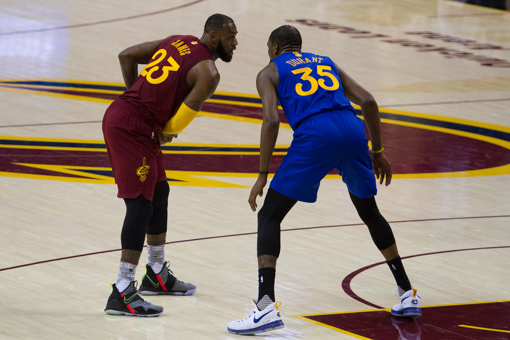 . LeBron James (23) of the Cleveland Cavaliers faces off against Kevin Durant (35) of the Golden State Warriors during an NBA game at the Quicken Loans Arena on Christmas day.  The Cavs defeated the Warriors 109-108.  Michael Johnson - The News Herald