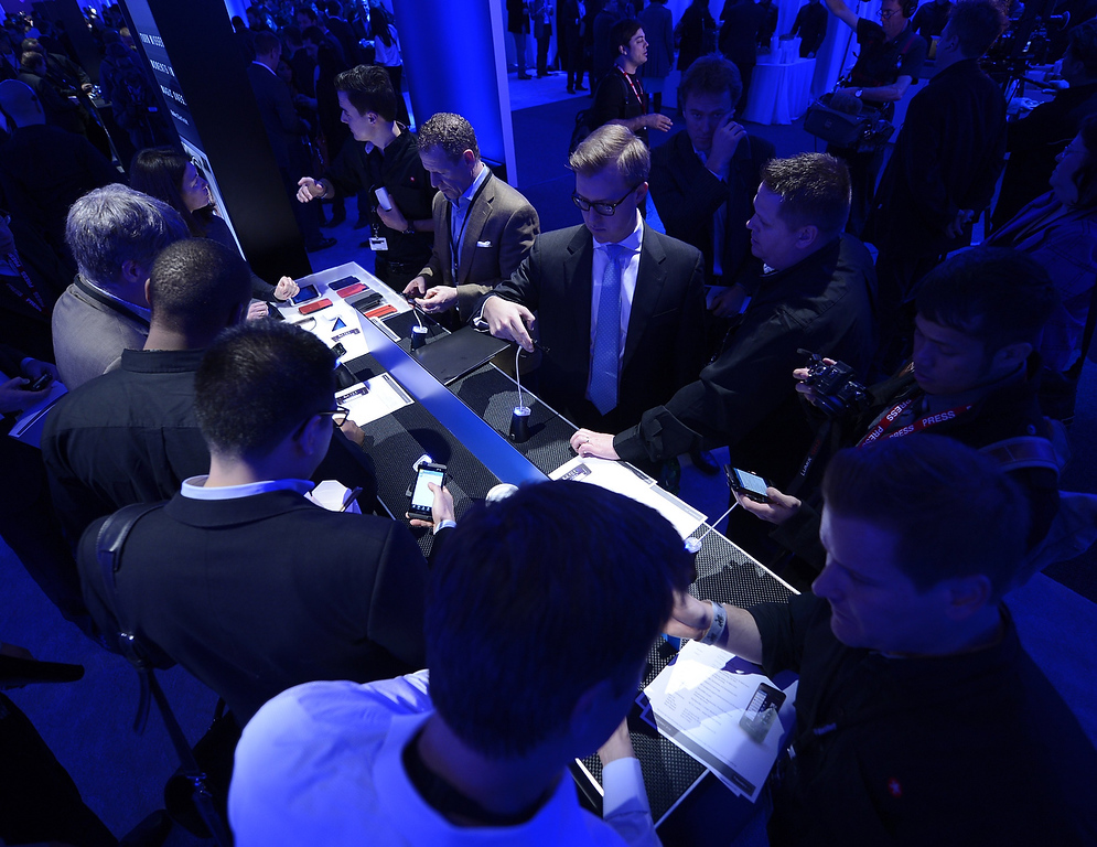 . Journalist view the BlackBerry 10 mobile platform after it was unveiled January 30, 2013 at the New York City Launch at Pier 36. (TIMOTHY A. CLARY/AFP/Getty Images)