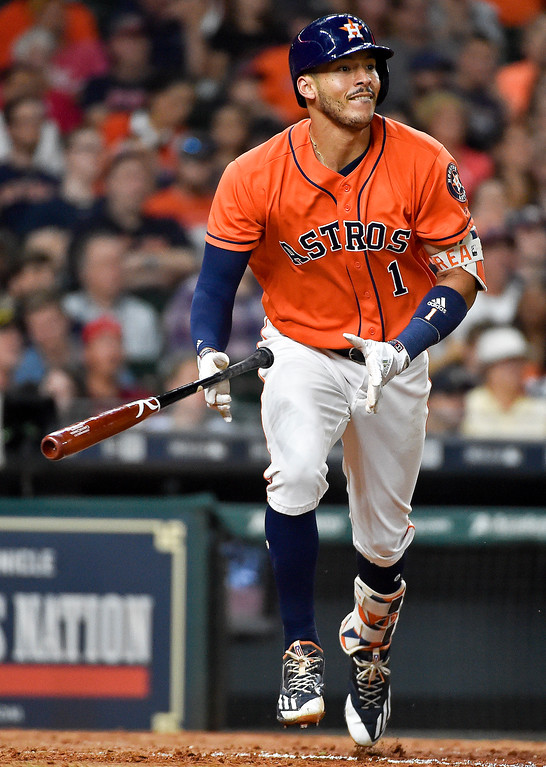 . Houston Astros\' Carlos Correa watches his solo home run off Cleveland Indians starting pitcher Trevor Bauer sixth inning of a baseball game, Friday, May 19, 2017, in Houston. (AP Photo/Eric Christian Smith)