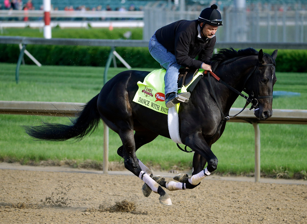 . Exercise rider Issac Muniz takes Kentucky Derby entrant Dance With Fate for a morning workout at Churchill Downs Thursday, May 1, 2014, in Louisville, Ky. (AP Photo/Morry Gash)