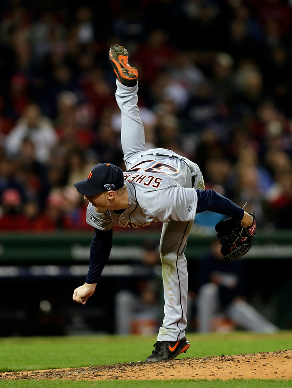 . Detroit Tigers starting pitcher Max Scherzer follows through on a pitch against the Boston Red Sox fifth inning during Game 6 of the American League baseball championship series on Saturday, Oct. 19, 2013, in Boston. (AP Photo/Charles Krupa)