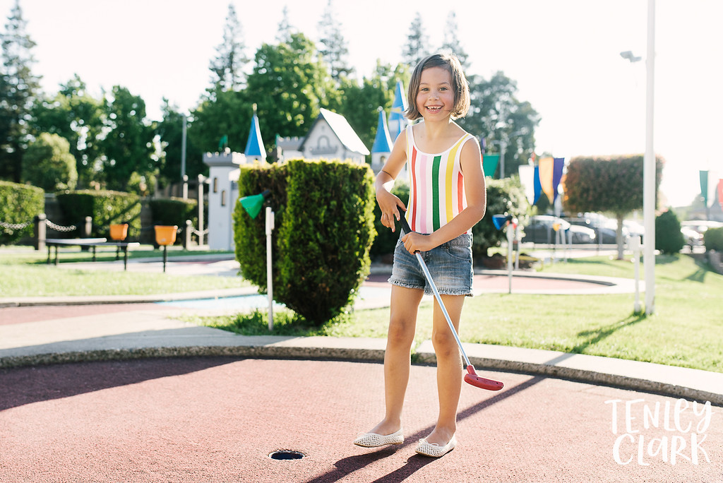 Bay Area playful and colorful lifestyle kid sisters shoot doing putt-putt miniature golf in Sunnyvale by Tenley Clark Photography