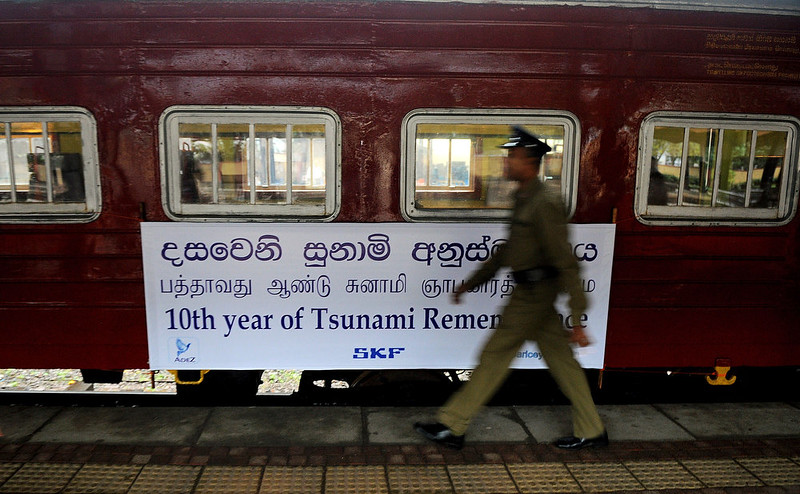 . A Sri Lankan railway employee walks past a train compartment that was swept away during the 2004 tsunami and later retrieved and restored, as the Ocean Queen Express prepares to set off from the Colombo Fort railway station in Colombo on December 26, 2014, the tenth anniversary of the deadly Asian tsunami. The same train was hit the tsunami, killing some 1,000 passengers, making it a symbol of the tragedy that claimed an estimated 31,000 people across the island.  Ishara S.KODIKARA/AFP/Getty Images
