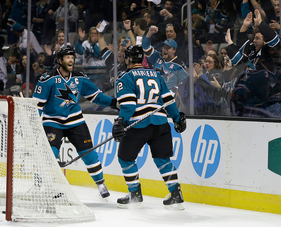 . San Jose Sharks center Patrick Marleau (12) celebrates with teammate Joe Thornton, left, after scoring his second goal of the first period of an NHL hockey game against the Colorado Avalanche in San Jose, Calif., Saturday, Jan. 26, 2013. (AP Photo/Marcio Jose Sanchez)