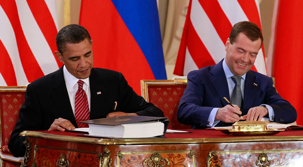 . President Barack Obama signs the New START treaty with Russian president Dmitry Medvedev at the Prague Castle in Prague Thursday, April 8, 2010. (AP Photo/Alex Brandon)