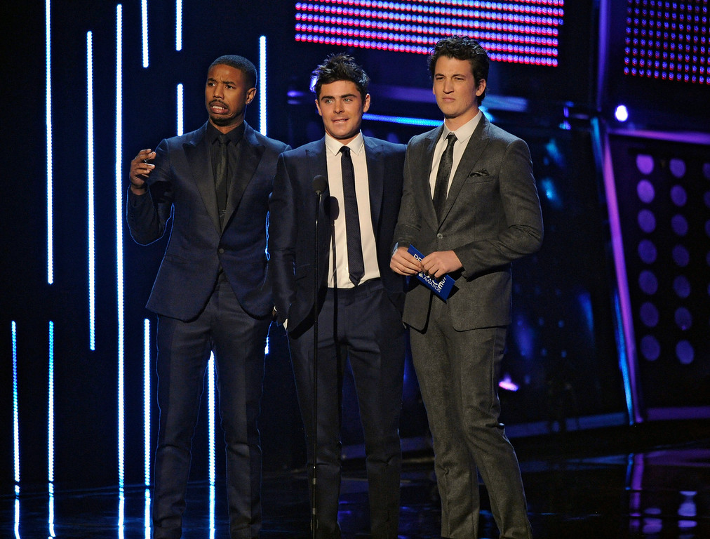 . From left, Michael B. Jordan, Zac Efron and Miles Teller present the award for favorite comedic movie at the 40th annual People\'s Choice Awards at the Nokia Theatre L.A. Live on Wednesday, Jan. 8, 2014, in Los Angeles. (Photo by Chris Pizzello/Invision/AP)