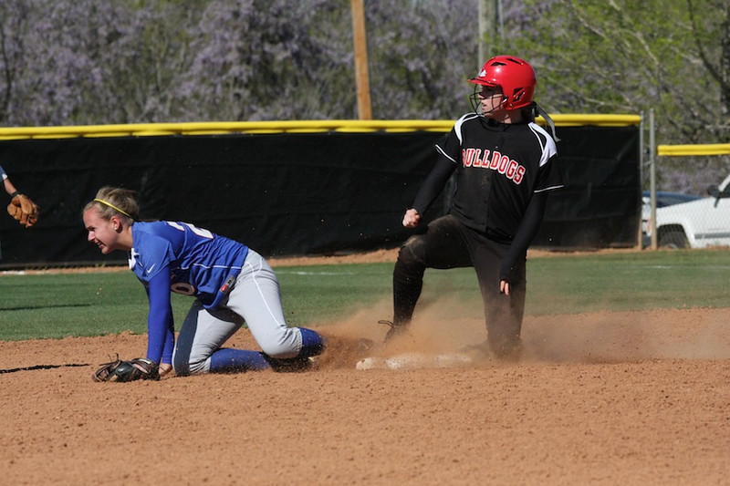 PC second baseman misses the ball as GWU advances to second.